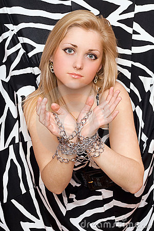 Beautiful woman stretches out her hands in chains