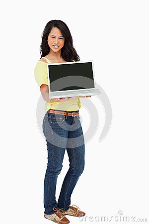 Beautiful woman student showing a laptop screen
