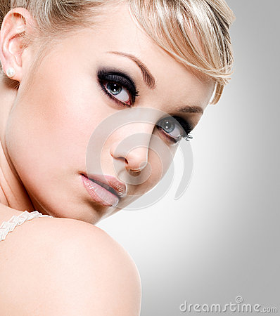 Beautiful  woman with style eye makeup.