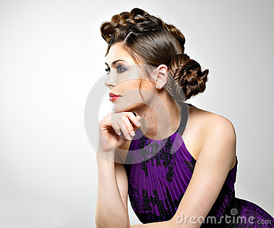Beautiful  woman with stylish hairstyle with pigtails design
