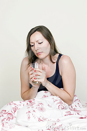 Beautiful woman suffering from flu in summer