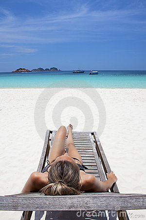 Beautiful woman sunbathing in paradise.