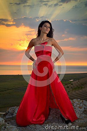 Beautiful woman at sunset/sunrise