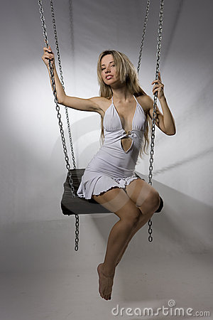Beautiful woman on swing
