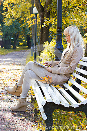 Beautiful woman with tablet pc outdoor