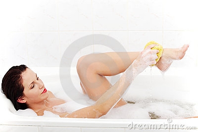 Beautiful woman taking the bath.