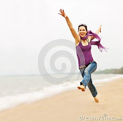 Beautiful woman taking a great leap