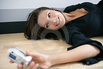 Beautiful woman taking photos herself