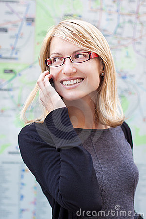 Beautiful woman talking by cell phone