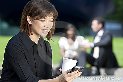 Beautiful Woman Texting & Drinking Coffee