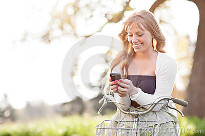 Beautiful woman texting on her phone outdoor