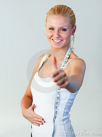 Beautiful woman with thumb up after weight loss