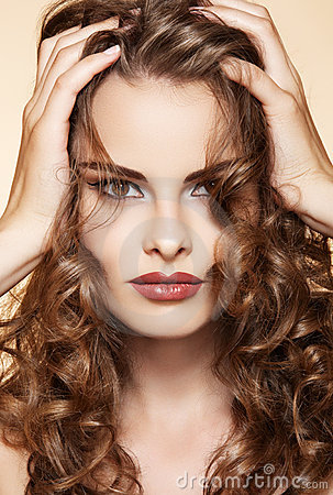 Free Beautiful Woman Touch Her Long Shiny Curly Hair Stock Images - 20443264