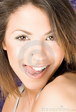 Beautiful  woman touch her up lip  by tongue