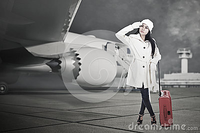 Beautiful woman travel in winter with luggage