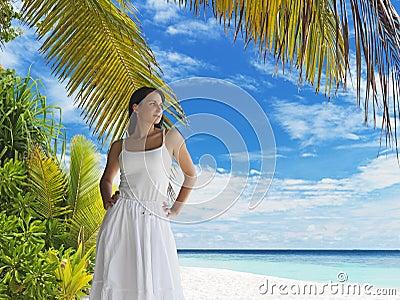 Beautiful woman on tropical beach