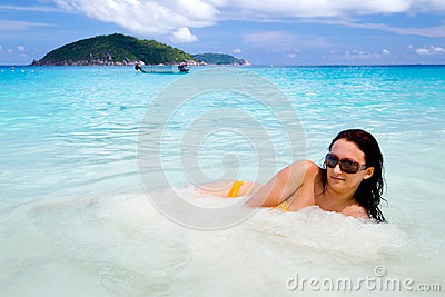 Beautiful woman in the tropical water