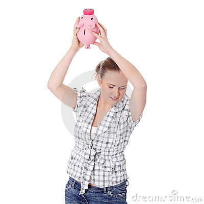 Beautiful woman trying to get money from her piggy