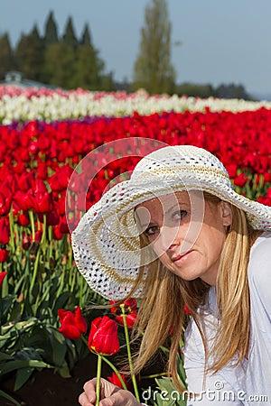 Beautiful woman in the tulip field
