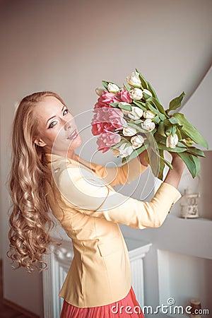 Beautiful woman with tulips