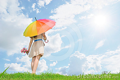 Beautiful woman with umbrella and cloud sky