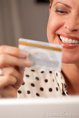 Beautiful Woman Using Laptop Holding Credit Card