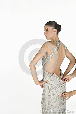 Beautiful Woman Waiting For Zip To Be Done Up On backless dress
