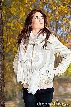Beautiful woman walking through  autumn  park