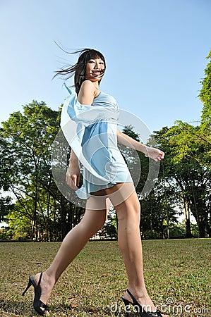 Beautiful Woman Walking In The Park