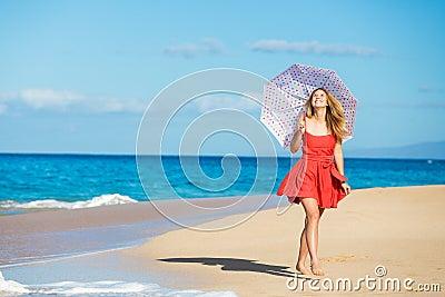 http://thumbs.dreamstime.com/x/beautiful-woman-walking-tropical-beach-27415732.jpg