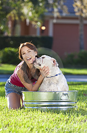 Beautiful Woman Washing Her pet Dog In A Tub