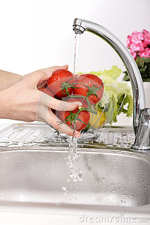 Free Beautiful Woman Washing Vegetables Stock Photo - 36733090