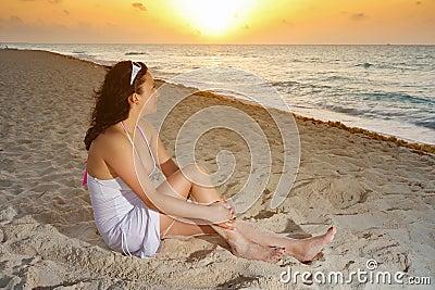 Beautiful woman watching sunrise