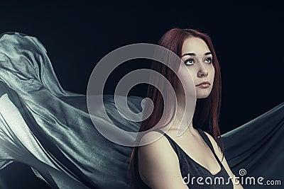 Beautiful woman and waving cloth