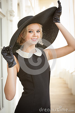 Free Beautiful Woman Wearing A Large Black Hat And Gloves Royalty Free Stock Photos - 28311928