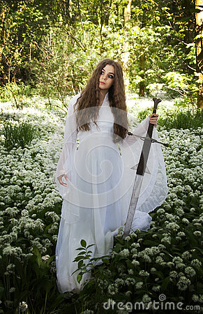 Free Beautiful Woman Wearing A Long White Dress Holding A Sword Royalty Free Stock Photos - 74195518