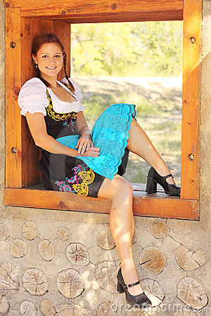 Beautiful Woman Wearing Bavarian Dirndl Dress