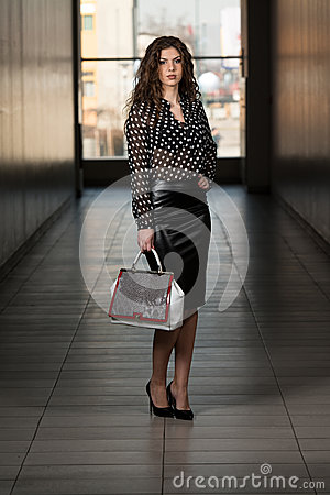 Beautiful Woman Wearing Black Leather Skirt Stock Images - Image ...