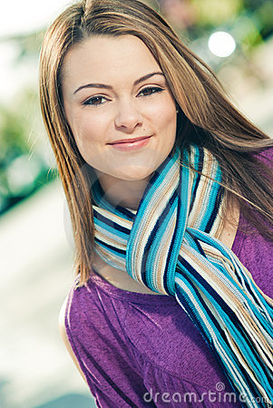 Beautiful woman wearing a blue scarf outdoors