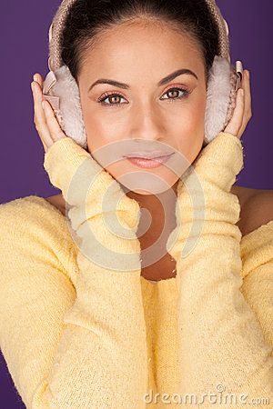 Free Beautiful Woman Wearing Ear Muffs Stock Photos - 27112453