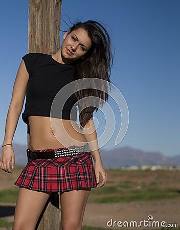 Beautiful woman wearing plaid mini skirt