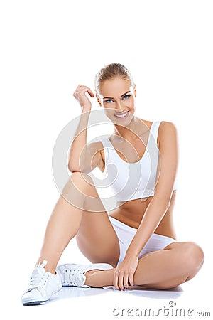 Beautiful woman wearing white underwear sitting