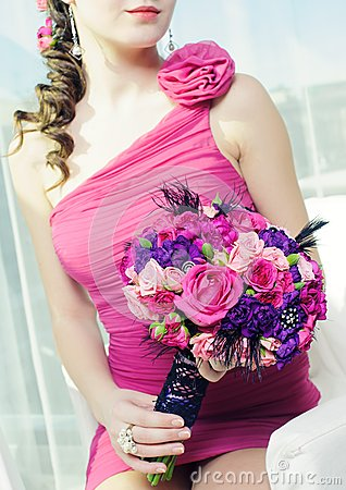 Woman with bouquet of roses