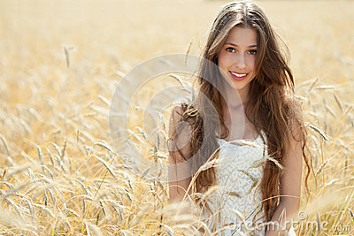 Beautiful woman in the wheat field