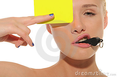 Beautiful woman with whistle and yellow card