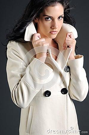 Beautiful woman in white coat