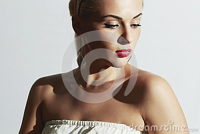 Beautiful woman in white dress.Fashion people.Pretty girl with red lips