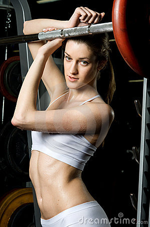 Beautiful woman who exercise in the sport club.