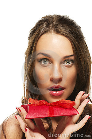 Beautiful woman with wide open eyes holding red pr