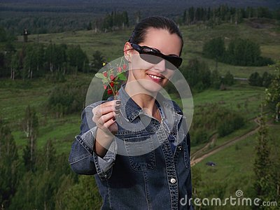 The beautiful  woman  with wild strawberry berries